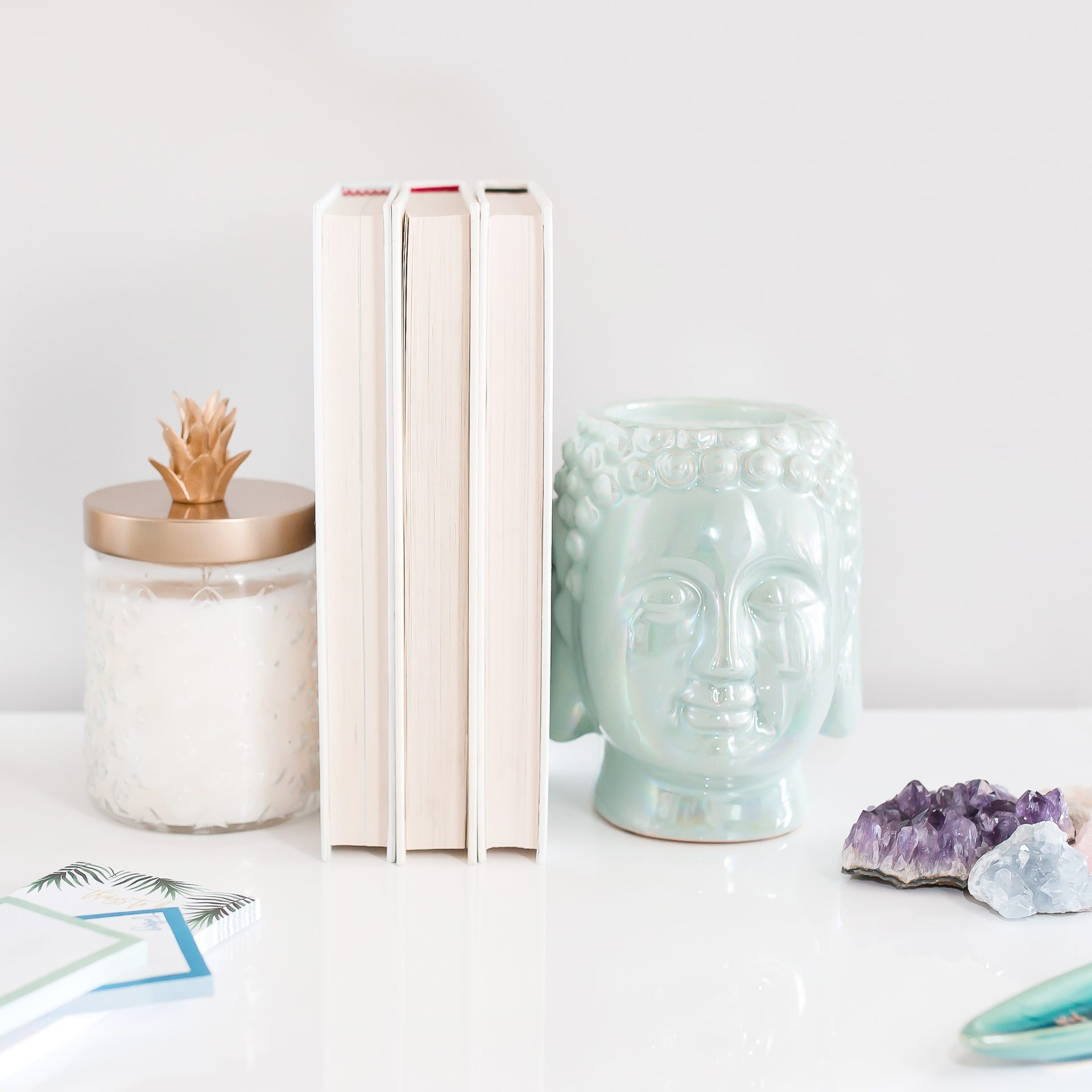 jade head statue and amethyst crystals on desk in home office